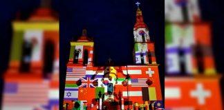 Iluminan iglesia de Santiago con banderas de países afectados por coronavirus